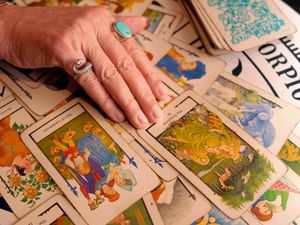 (Cheryl Gerber | AP) A psychic and tarot card reader reads a spread of tarot cards in 2007 in New Orleans. A new study shows young people in traditional faiths are also turning to divination.
