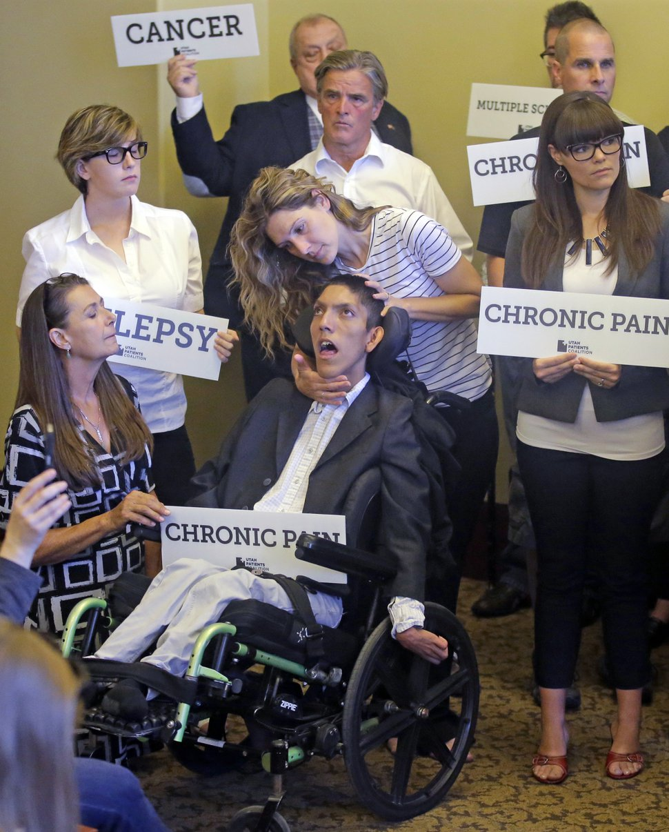 Rick Bowmer | AP Photo Desiree Hennessy, center, attends to her adopted son Hestevan, who has Cerebral Palsy and suffers from chronic nerve pain, seizure disorder, during the Utah Patients Coalition news conference Monday, June 26, 2017, in Salt Lake City. A group of activists and Utah residents with chronic conditions has launched a ballot initiative to ask voters next year to pass a broad medical marijuana law.