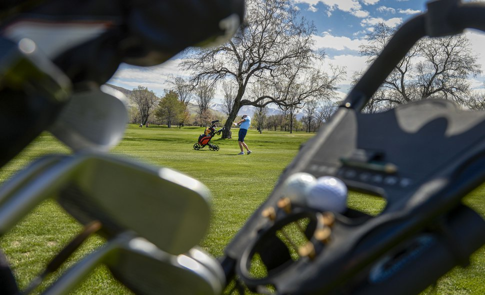 (Leah Hogsten | The Salt Lake Tribune) Kevin Pyle fires off the fairway at Rose Park Golf Course while playing with a friend, April 9, 2020. Despite the coronavirus and social distancing requirements, Pyle manages to play at least five times a week.