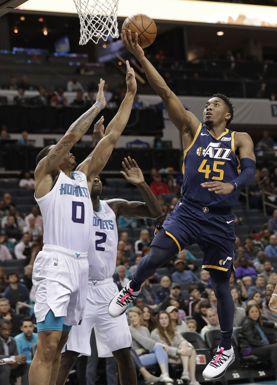 Utah Jazz's Donovan Mitchell (45) drives against Charlotte Hornets' Miles Bridges (0) during the first half of an NBA basketball game in Charlotte, N.C., Friday, Nov. 30, 2018. (AP Photo/Chuck Burton)