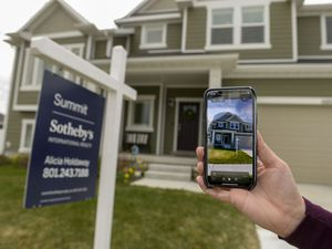(Leah Hogsten  |  Tribune file photo) Third-quarter home sales along the Wasatch Front were 13% above the same level last year, wiping away the market effects of COVID-19 lockdowns and related slowdowns in April and May. Real estate agents say Utah is drawing lots of out-of-state buyers right now.