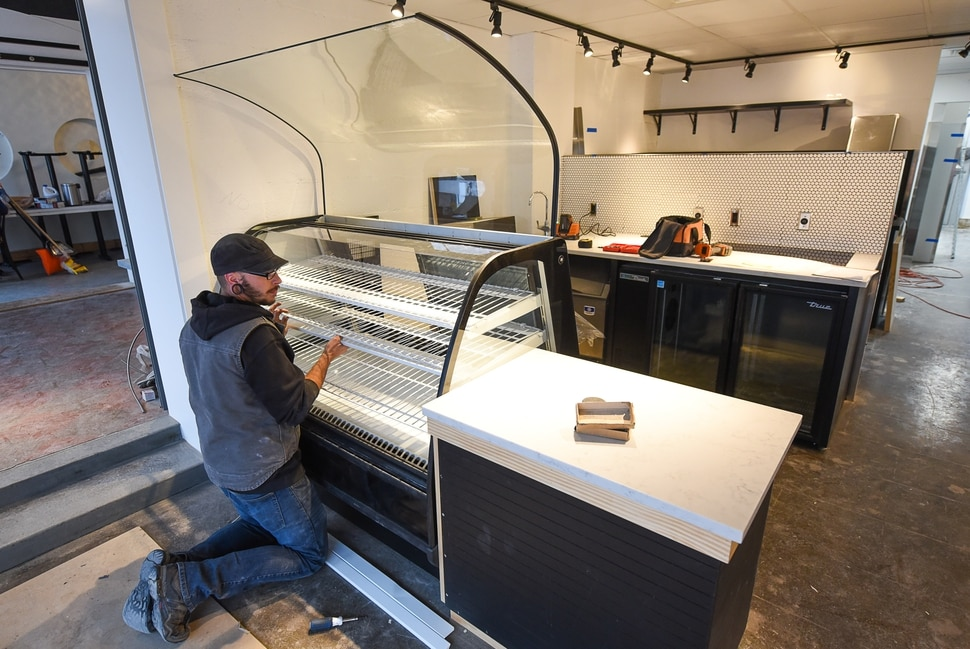 (Francisco Kjolseth | The Salt Lake Tribune) Cameron Isaac works on the final details at Stratford Proper, the fourth sibling in the Proper chain (along with Proper Brewing, Avenues Proper and Proper Burger) which opens Dec. 10 at 1588 E.Stratford Ave. It's located in the old Per Noi Italian restaurant space.