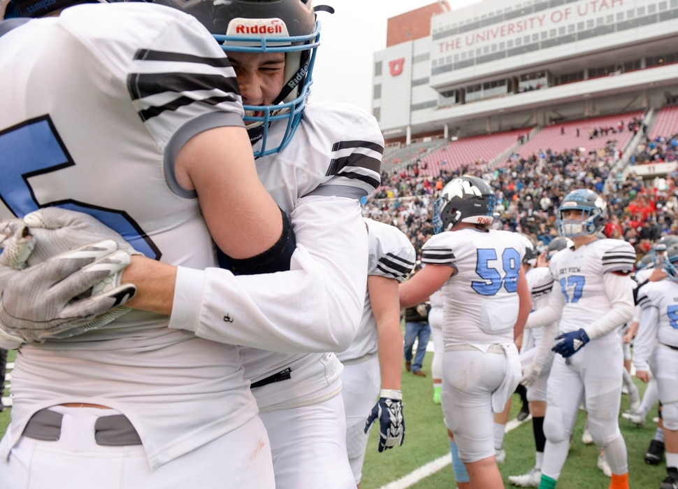 (Leah Hogsten | The Salt Lake Tribune) Sky ViewÕs Tate Ballard and Kason Flaherty celebrate the win. Sky View High School defeated Park City 35-0 to win the 4A State Championship football title, Nov. 11, 2019 at Rice-Eccles Stadium.