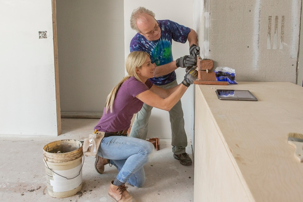 """(Photo courtesy Menesa Pritchett/HGTV) Jasmine Roth and Mike Lookinland work on the house in """"A Very Brady Renovation."""""""
