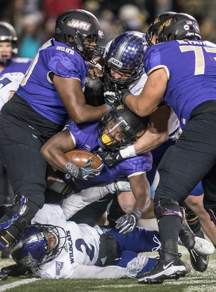 James Madison running back Trai Sharp (1) gets stuck in traffic during the first half of an NCAA college football game against Weber State in the quarterfinals of the FCS playoffs Friday, Dec. 8, 2017, in Harrisonburg, Va. (Daniel Lin/Daily News-Record via AP)