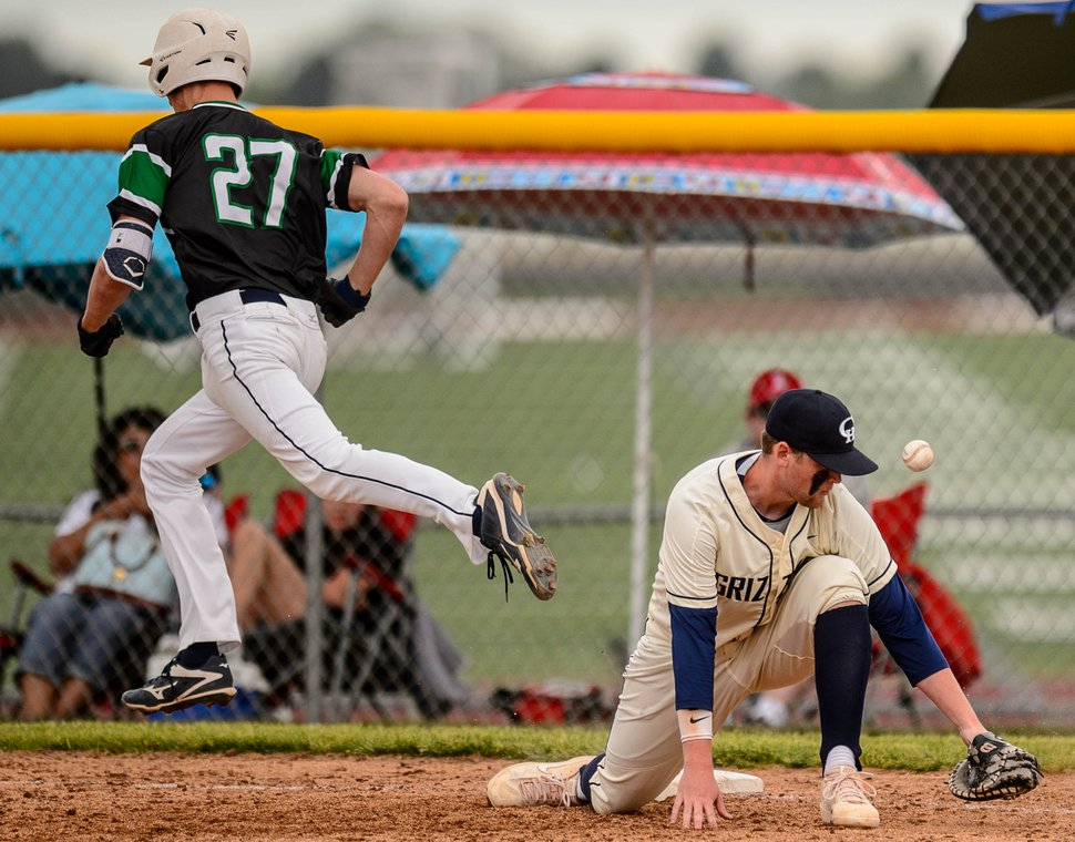 (Trent Nelson | The Salt Lake Tribune) Syracuse's Kyler Stromberg is safe at first, with Copper Hills's Cole Booth at first, as Copper Hills faces Syracuse High School in the Last Chance Baseball Tournament at Lone Peak High School in Highland on Friday, May 29, 2020.