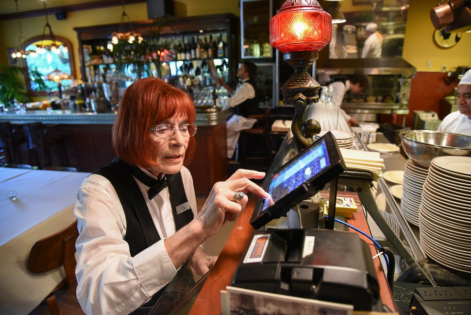 (Francisco Kjolseth | The Salt Lake Tribune) Flo Blank, a waitress at The Paris Bistro in Salt Lake City, works the cash register in this archive photo. The French-inspired restaurant is closed.