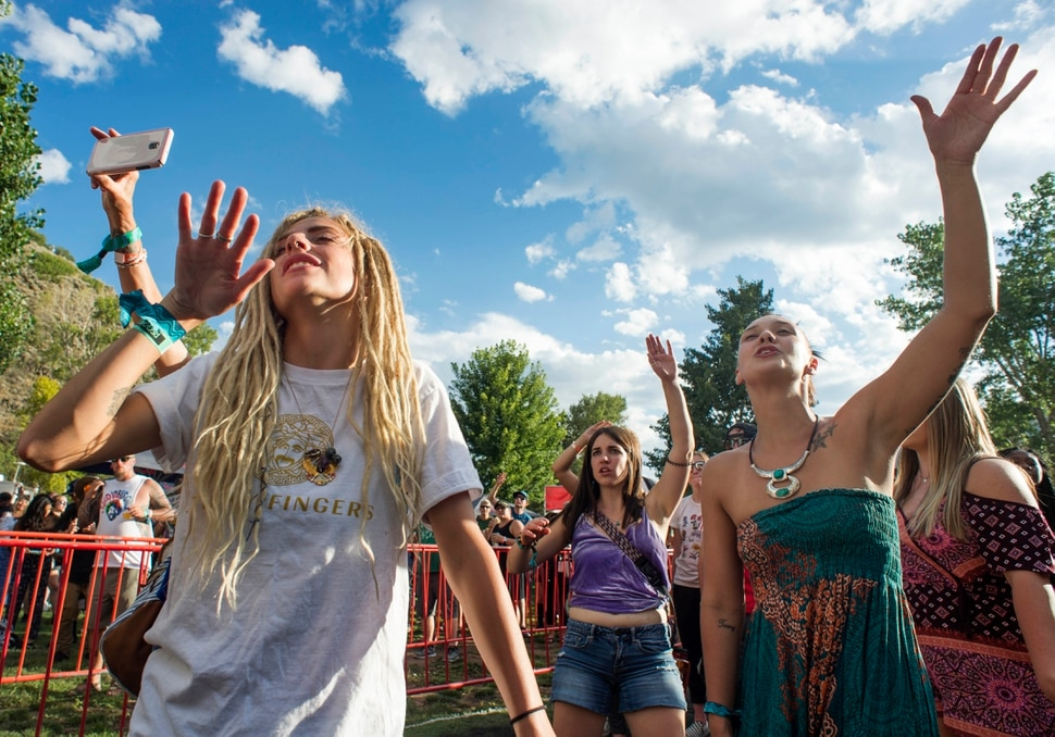 (Rick Egan | The Salt Lake Tribune) Whitney Johnson and Cheyenne Thompson, dance to the music of Red Sage on the opening day of the 3-day Reggae Rise Up Festival at the Rivers Edge in Heber City, Friday, Aug. 24, 2018.