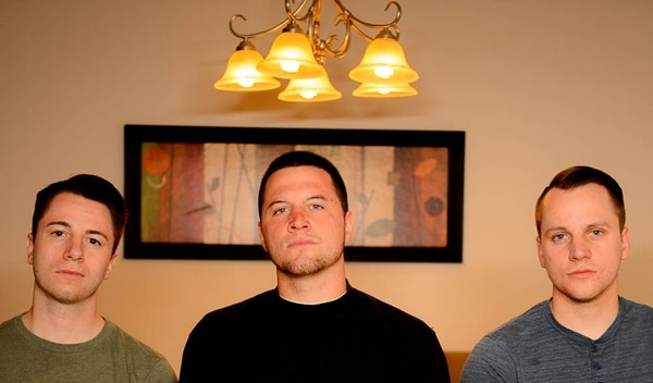 (Trent Nelson | The Salt Lake Tribune) Three brothers are trying to get their father's conviction as a sex offender vacated. Two of the brothers (Jeremy and Nathan Hawkins) lied about being sexually abused by their dad when they were kids. Now they are in their early 20s and are trying to fix what they did 12 years ago. Ian, Jeremy, and Nathan Hawkins in Magna, Tuesday July 31, 2018.