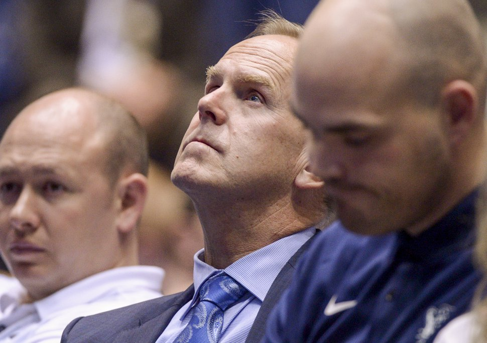 (Leah Hogsten   The Salt Lake Tribune) BYU athletic director Tom Holmoe listens as BYU basketball coach Dave Rose talks about his career.