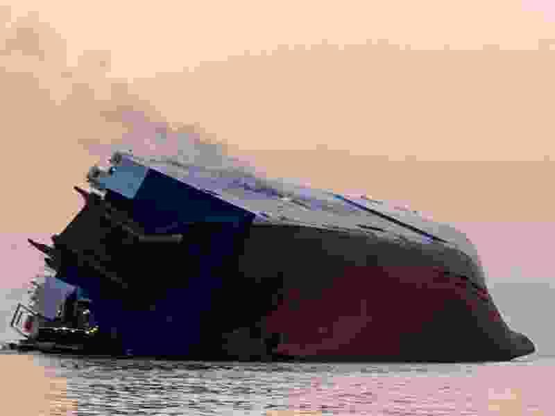 Coast Guard searching for 4 aboard flipped cargo ship near Brunswick