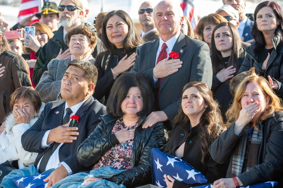 (Rick Egan   The Salt Lake Tribune) Family members of Army Chief Warrant Officer 2 Kirk T. Fuchigami Jr. watch as Apache helicopters fly over the Brigham City Cemetery, Monday, Dec. 9, 2019, during the graveside service for Fuchigami, who was killed in Afghanistan last month.