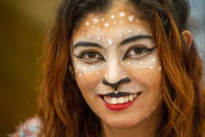 (Rick Egan  |  The Salt Lake Tribune) Artist Consu Nikolazza painted her face Sunday to advertise her face painting at the booth where she sells her art at the second annual Made in Utah Winter Fest at The Gateway.  The free festival includes local artists, musicians, artisans, breweries, distilleries, food trucks, and other local businesses, to help promote shopping locally for holidays. The Utah Winter Fest continues December 21 & 22. Sunday, Dec. 15, 2019.