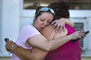 (Nick Wagner | Austin American-Statesman via AP) Carrie Matula embraces a woman after a fatal shooting at the First Baptist Church in Sutherland Springs, Texas, on Sunday, Nov. 5, 2017. Matula said she heard the shooting from the gas station where she works a block away.