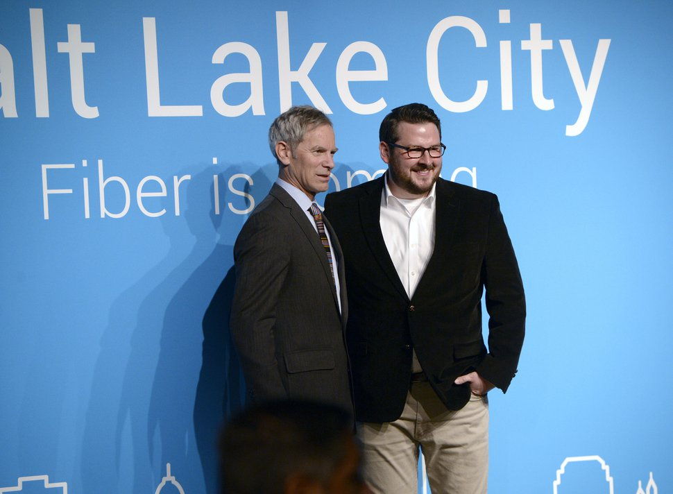 (Al Hartmann | Tribune file photo) Former Salt Lake City Mayor Ralph Becker, left, and Devin Baer, Google's Assistant City Manager for Google Salt Lake City, announce in 2015 that Salt Lake City was being studied as a candidate to host a fiber-optic network offering gigabit internet speeds. The Mountainview, Calif-based company chose Utah's capitol as a Fiber city the following year.