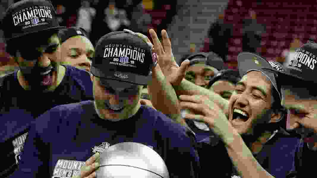 Sam Merrill leads Utah State to MW tournament title, after witnessing the Aggies' last NCAA-worthy effort