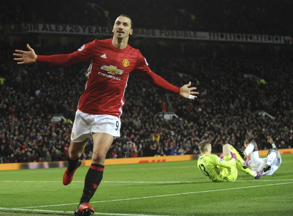 FILe - In this Dec. 26, 2016, file photo, Manchester United's Zlatan Ibrahimovic, left, celebrates after scoring his side's second goal during an English Premier League soccer match against Sunderland at Old Trafford in Manchester, England. Sources with knowledge of the deal say Ibrahimovic has signed a two-year contract with Major League Soccer to leave Manchester United and join the LA Galaxy. The sources spoke to The Associated Press on the condition of anonymity Thursday, March 22, 2018, because the deal had not been announced. The agreement was first reported by the Los Angeles Times. (AP Photo/Rui Vieira, File)