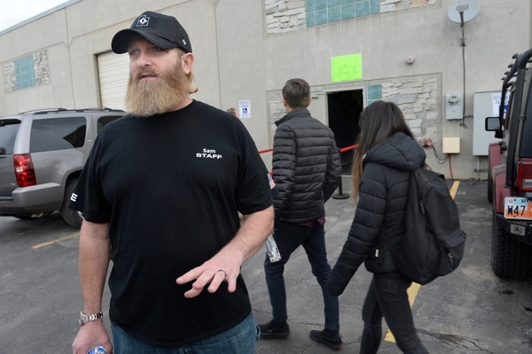 Scott Sommerdorf | The Salt Lake Tribune Concealed carry instructor Sam Robinson who is co-owner of The Gun Exchange, speaks to media as some of the 1,000 attendees arrive to attend a free concealed carry gun class Saturday for Utah teachers and students, Saturday, March 3, 2018.