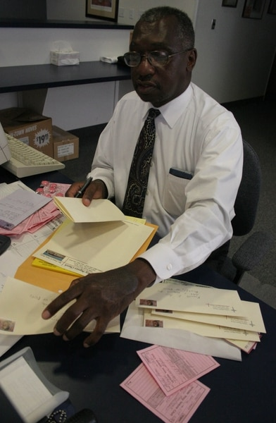 (Jim Urquhart | Tribune file photo) Rev. France Davis writes thank you letters to all those who donated good and supplies to hurricane Katrina victims, Sept. 8, 2005.