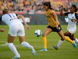 (Francisco Kjolseth  |  The Salt Lake Tribune)  Utah Royals FC forward Christen Press (23) tries to push past the defense as Utah Royals FC hosts the North Carolina Courage at Rio Tinto Stadium in Sandy, Utah on Saturday, July 27, 2019.