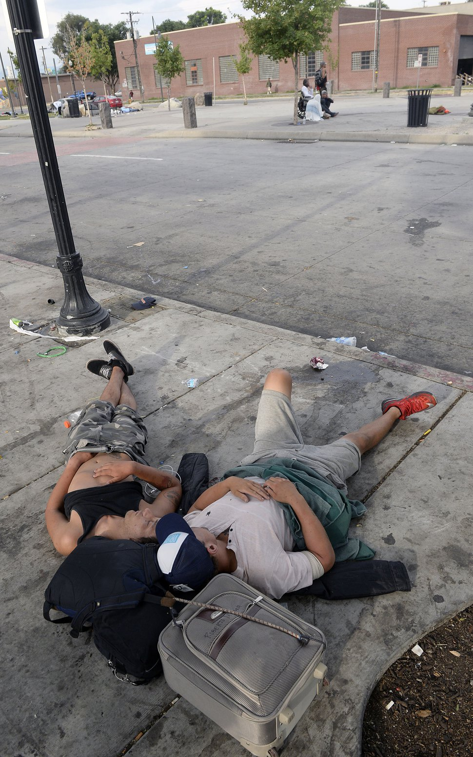 Al Hartmann | The Salt Lake Tribune People sleep on sidewalk near 200 S. and 500 W. Wednesday morning July 19. Camping on the street is a class B misdemeanor and can now be enforced.
