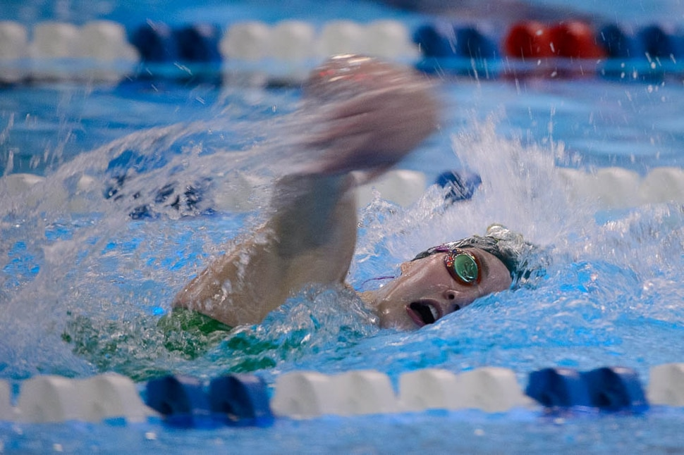 (Trent Nelson | The Salt Lake Tribune) Kearns High School's Keely Christenot wins the Women 200 Yard Freestyle at the high school swimming 6A State Championships in Bountiful, Thursday February 8, 2018.