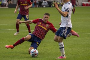 (Rick Egan | The Salt Lake Tribune) Real Salt Lake defender Aaron Herrera (22) steals the ball as Vancouver Whitecaps defender Cristian Gutierrez (3) leaps over him, in MSL action between Real Salt Lake and the Vancouver Whitecaps at Rio Tinto Stadium, on Friday, June 18, 2021.