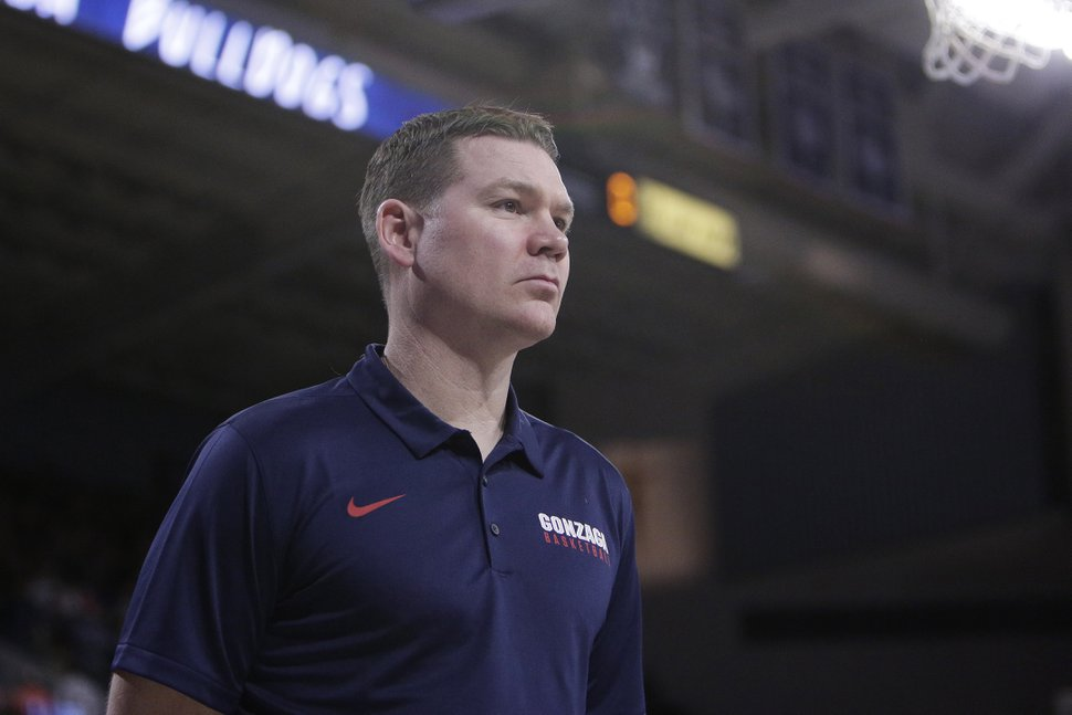 Gonzaga assistant coach Tommy Lloyd stands on the court before an NCAA college basketball game against San Francisco in Spokane, Wash., Saturday, Jan. 27, 2018. (AP Photo/Young Kwak)