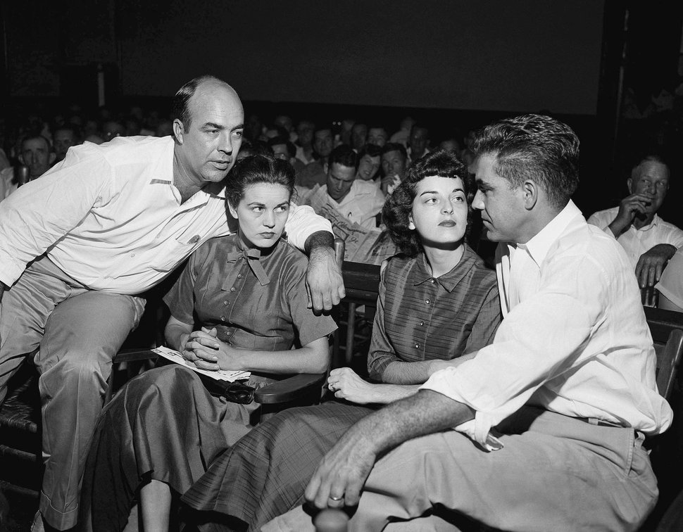 FILE - In this Sept. 23, 1955, file photo, J.W. Milam, left, his wife, second left, Roy Bryant, far right, and his wife, Carolyn Bryant, sit together in a courtroom in Sumner, Miss. Bryant and his half-brother Milam were charged with murder but acquitted in the kidnap-torture slaying of 14-year-old black teen Emmett Till in 1955 after he allegedly whistled at Carolyn Bryant. The men later confessed in a magazine interview but weren't retried; both are now dead. Citing