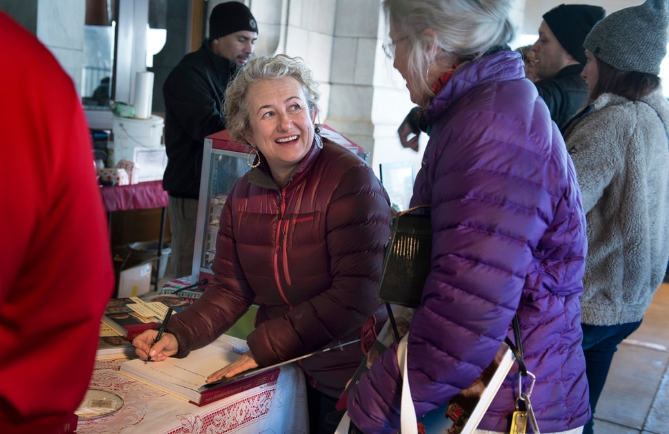 (Scott Sommerdorf | The Salt Lake Tribune) Blake Spalding, co-owner of Hell's Backbone Grill in Boulder, signs a copy of the new cookbook, This Immeasurable Place: Food and Farming from the Edge of Wilderness, for Margie Batson, December 9, 2017.