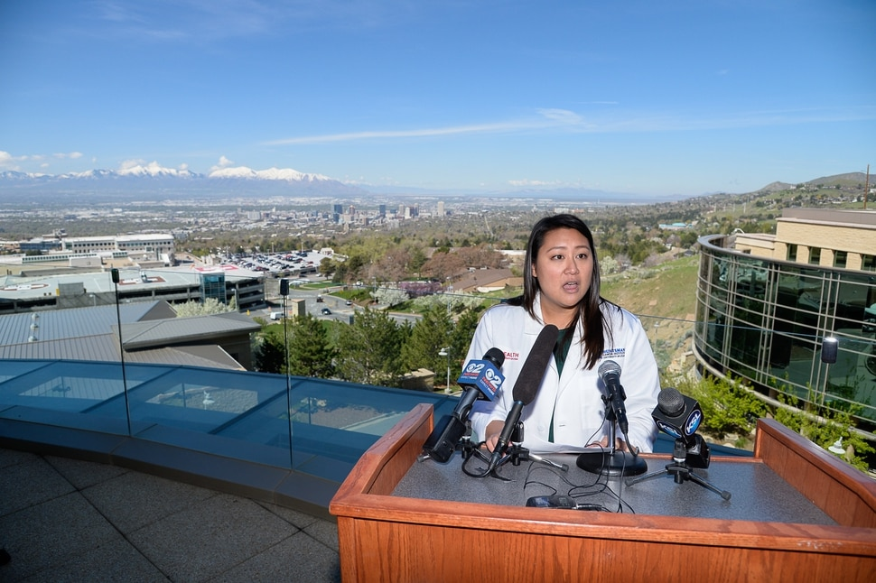 (Francisco Kjolseth | The Salt Lake Tribune) Judy Ou, PhD, cancer epidemiologist at Huntsman Cancer Institute is framed by the Salt Lake valley on Tuesday, March 23, 2019, as she discusses a study conducted by researchers at HCI that indicates air pollution is a health risk for childhood cancer survivors.