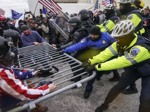 (John Minchillo, AP file photo) In this Jan. 6, 2021, file photo, Trump supporters try to break through a police barrier at the Capitol in Washington. The LDS Church is speaking out against the political violence.