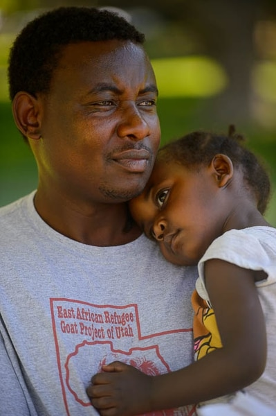 (Trent Nelson | The Salt Lake Tribune) Gustave Deogratiasi and his daughter Amina at World Refugee Day in Salt Lake City, Saturday, June 23, 2018. The free community celebration and festival included live cultural entertainment, ethnic food, global market and kids' activities.