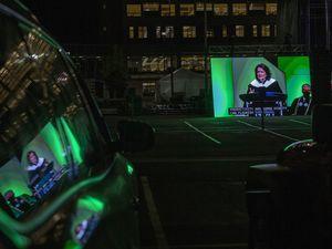 (Rick Egan | The Salt Lake Tribune) Graduates listen in their cars as commencement speaker Wendy Watson Nelson talks at Utah Valley University in Orem on Friday, May 7, 2021.