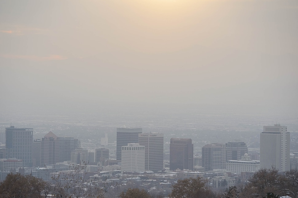 (Trent Nelson | The Salt Lake Tribune) The Salt Lake City skyline on a hazy day, Thursday Dec. 6, 2018.