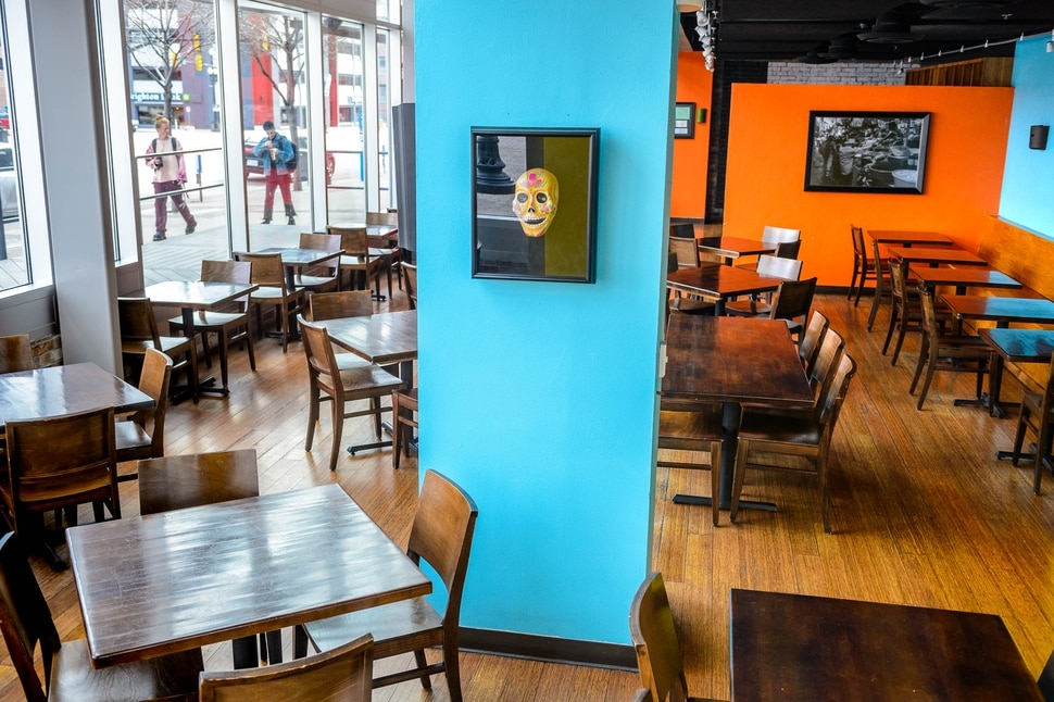 (Trent Nelson | The Salt Lake Tribune) An empty dining room at Alamexo Mexican Kitchen in Salt Lake City after the establishment announced the closure of dine in service on Monday, March 16, 2020.
