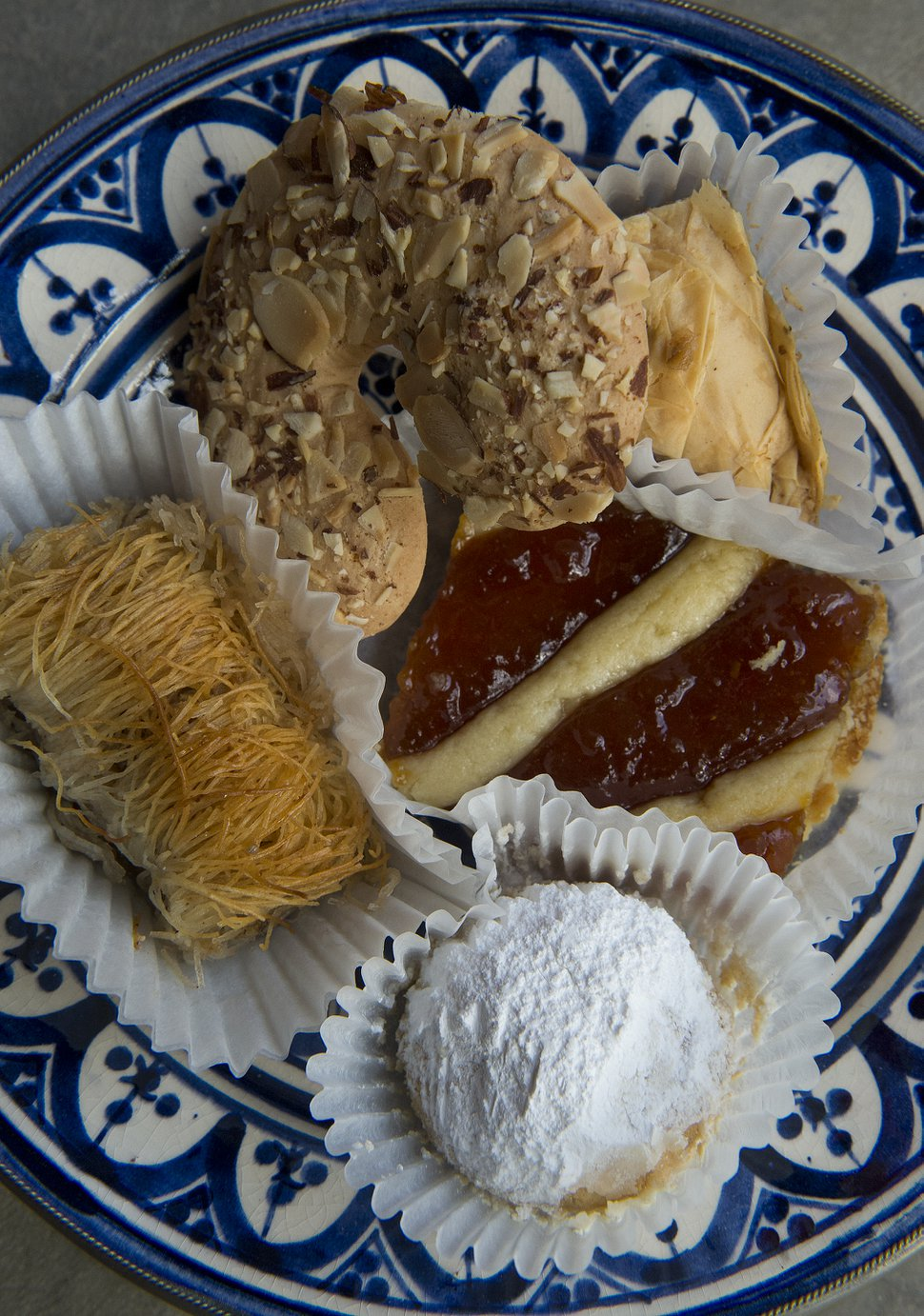 (Leah Hogsten | Tribune file photo) A plate of baklava, kataifi, kourambiedes and pasta flora at the 42nd annual Greek Festival. With this year's festival canceled because of COVID-19, organizers are holding a one-day pastry event at Holy Trinity Cathedral Greek Orthodox Church on Saturday, Oct. 17, 2020.