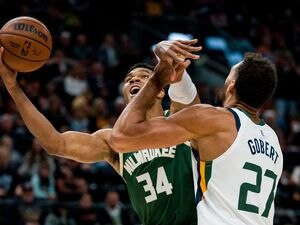 (Trent Nelson     The Salt Lake Tribune) Utah Jazz center Rudy Gobert (27) defends Milwaukee Bucks forward Giannis Antetokounmpo (34) as the Utah Jazz host the Milwaukee Bucks, NBA basketball in Salt Lake City on Wednesday, Oct. 13, 2021.