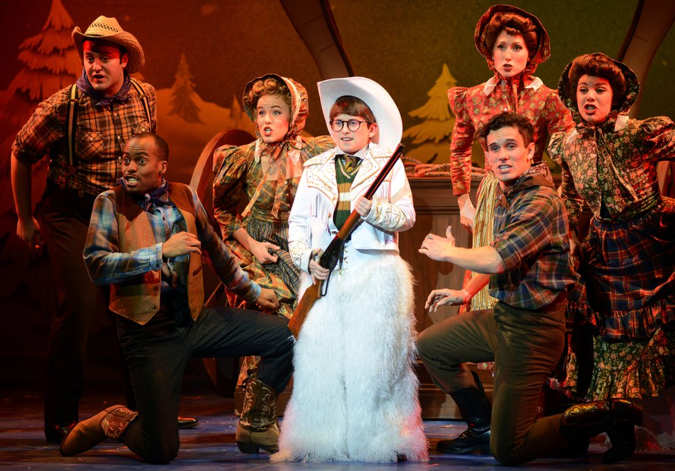 (Photo courtesy of Broadway at the Eccles) Ralphie, played by Colton Maurer, holds his much-desired Red Ryder BB gun, in a scene from the musical