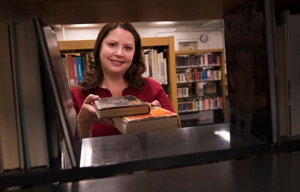 Leah Hogsten   The Salt Lake Tribune Older male inmates tend to enjoy reading old Westerns. Female inmates tend to enjoy the romance section. Both groups enjoy science fiction. Utah State Prison librarian, Christie Jensen, has managed the prison's five libraries for over 11 years.