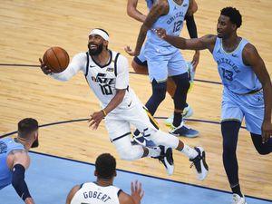 Utah Jazz guard Mike Conley (10) goes to the basket past Memphis Grizzlies forward Jaren Jackson Jr. (13) during the second half of Game 3 of an NBA basketball first-round playoff series Saturday, May 29, 2021, in Memphis, Tenn. Utah won 121-111. (AP Photo/John Amis)