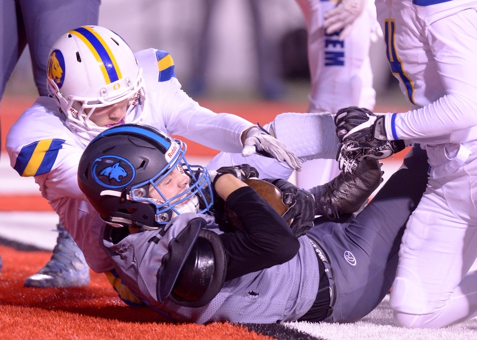 (Leah Hogsten | The Salt Lake Tribune) Sky View's Mason Falslev pulls down the touchdown over Orem's Chris Daley in their class 4A state semifinal game at Rice-Eccles Stadium, Friday, Nov. 10, 2017.