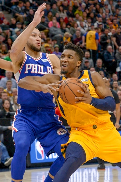 Leah Hogsten | The Salt Lake Tribune Utah Jazz guard Donovan Mitchell (45) drives the lane past Philadelphia 76ers guard Ben Simmons (25) as the Utah Jazz host the Philadelphia 76ers at Vivint Smart Home Arena, Thursday, December 27, 2018.