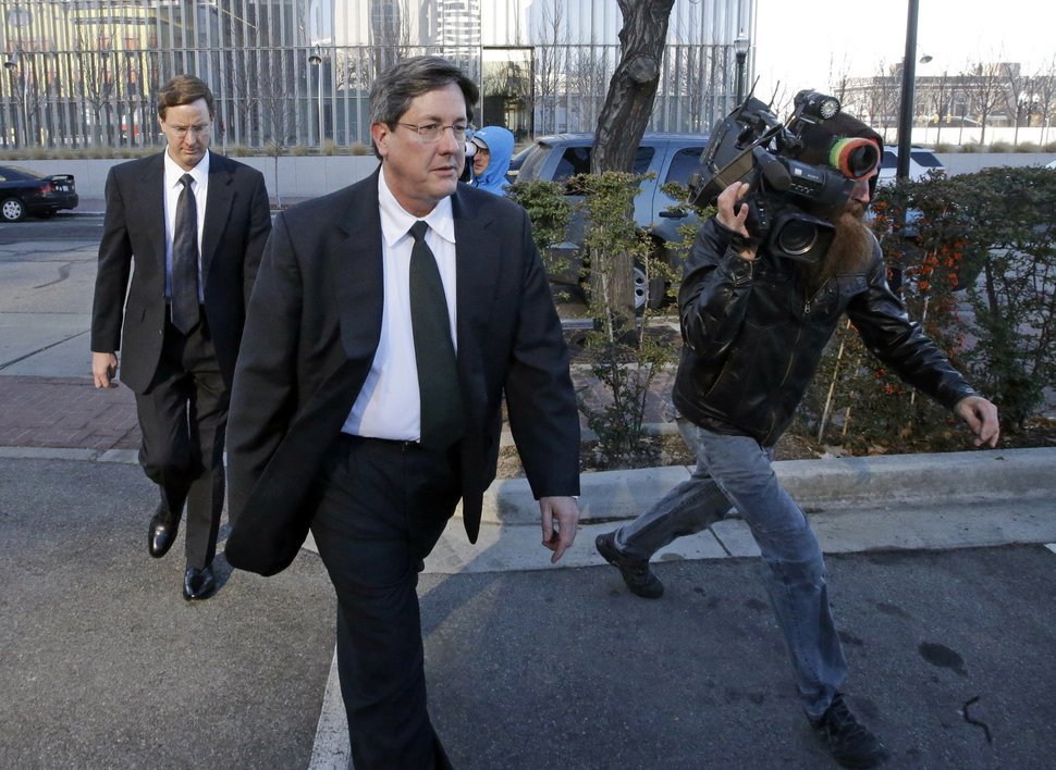FILE - In this Wednesday, Jan. 21, 2015 file photo, brothers of polygamous sect leader Warren Jeffs, Lyle, foreground, and Nephi, leave the federal courthouse in Salt Lake City. Though Warren Jeffs been in jail in Utah or Texas continually since 2006, he is believed to still rule the Fundamentalist Church of Jesus Christ of Latter-Day Saints through letters and phone calls from prison. Lyle Jeffs makes sure Jeffs' commandments are carried out. To his followers, roughly estimated to be about 6,000, he is a prophet who speaks for God and can do no wrong. (AP Photo/Rick Bowmer)