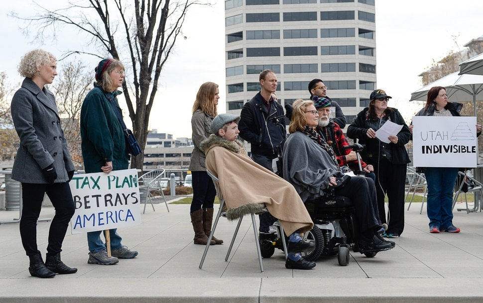 (Francisco Kjolseth | The Salt Lake Tribune) A group of Utahns rally at the Wallace Bennett Federal Building in Salt Lake on Monday, Nov. 20, 2017, to tell personal stories of how they might be impacted by the tax reform plans currently on the table in Congress.
