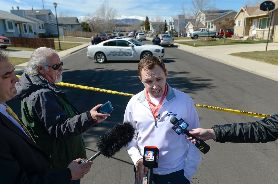 (Francisco Kjolseth | The Salt Lake Tribune) Granite School Communications Director Ben Horsley gives an update at the scene of where a Granite School District police officer shot a driver on Tuesday afternoon, March 20, 2018. While on patrol near Hunter High School, the officer noticed a car full of teenagers and smelled marijuana. When he approached the car lurched and he ended up on the hood. The driver was shot and four other teens in the car fled the scene.