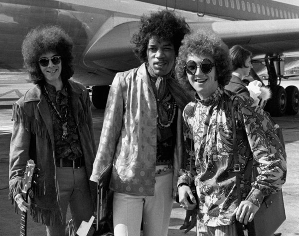 FILE - This Aug. 21, 1967 file photo shows bass guitarist Noel Redding, left, guitarist Jimi Hendrix, center, and drummer Mitch Mitchell, of the Jimi Hendrix Experience, at Heathrow airport in London. (AP Photo/Peter Kemp, File)