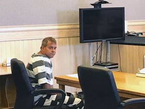 (Steve Ranson/Lahontan Valley News via AP) FILE - John K. O'Connor looks back before the judge reads an indictment in justice court, Wednesday, July 25, 2018 in Fallon, Nev. O'Connor, a 48-year-old northern Nevada man accused of fatally shooting a fellow member of his congregation during Sunday services at a Mormon church has been indicted on murder, battery and assault charges. A district judge issued the ruling based on his finding that John O'Connor of Fallon is unable to assist his attorney with his defense, the Lahontan Valley News reported.