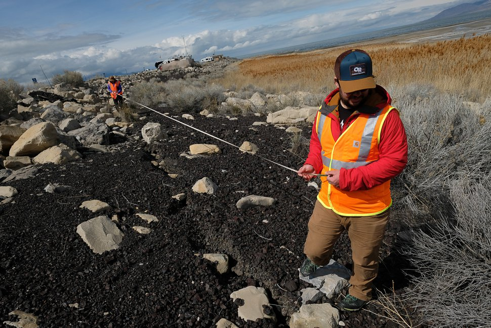 (Francisco Kjolseth | The Salt Lake Tribune) Emily Kleber and Adam Hiscock, both hazard geologists for the Utah Geological Survey, measure an extensive crack or lateral spread at the Great Salt Lake on Thursday, March 19, 2020, after Wednesday's earthquake.