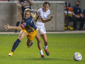 (Rick Egan  |  The Salt Lake Tribune)   Utah Royals FC forward Amy Rodriguez (8) goes for the ball along with Portland Thorns FC defender Emily Menges (5), in soccer action between Utah Royals FC and Portland Thorns FC at Rio Tinto Stadium, on Saturday, Oct. 3, 2020.
